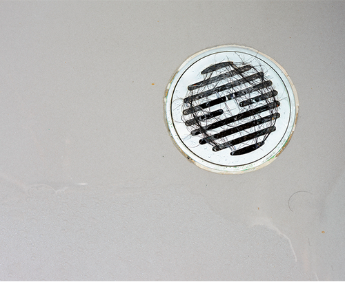 shower drain clogged with hair
